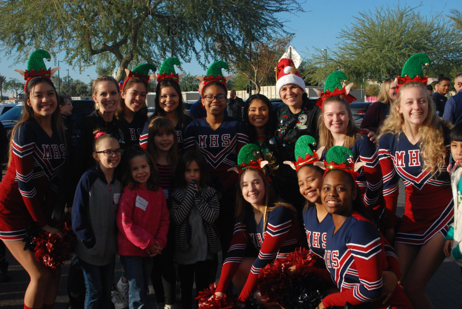 McClintock+Varsity+Cheer+volunteered+with+Tempe+Police+in+an+annual+event+known+as+%22Shop+with+a+Cop.%22