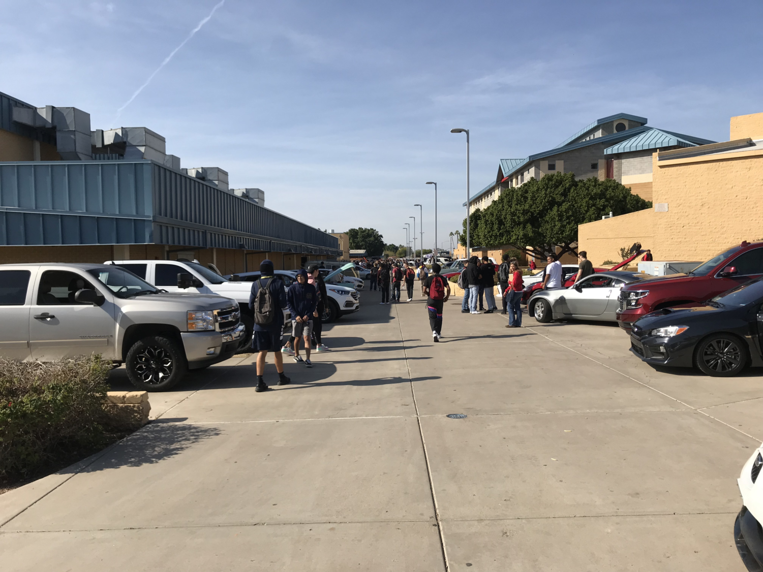 Students and staff take a look at a variety of cars during the annual McClintock Dream Car Show.