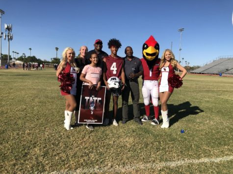 McClintock Senior Bryce Tate (#4) stands with his family after being presented the Arizona Cardinals Player of the Week award.